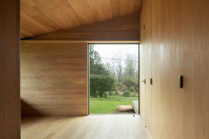 Divine House. Primary bedroom garden view