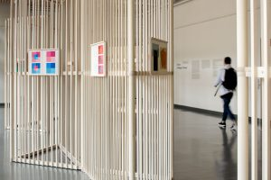 Josef Albers Exhibition. Detail with a student walking by